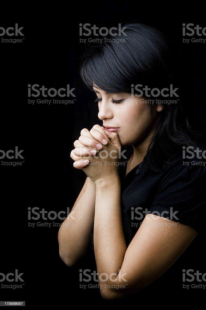Adorable woman praying royalty-free stock photo