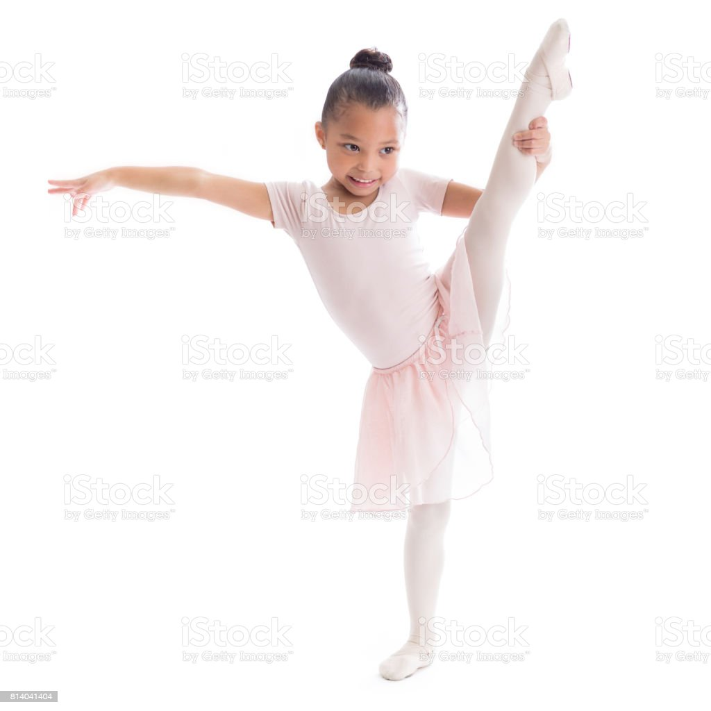 Adorable young African American ballerina in ballet pose stock photo