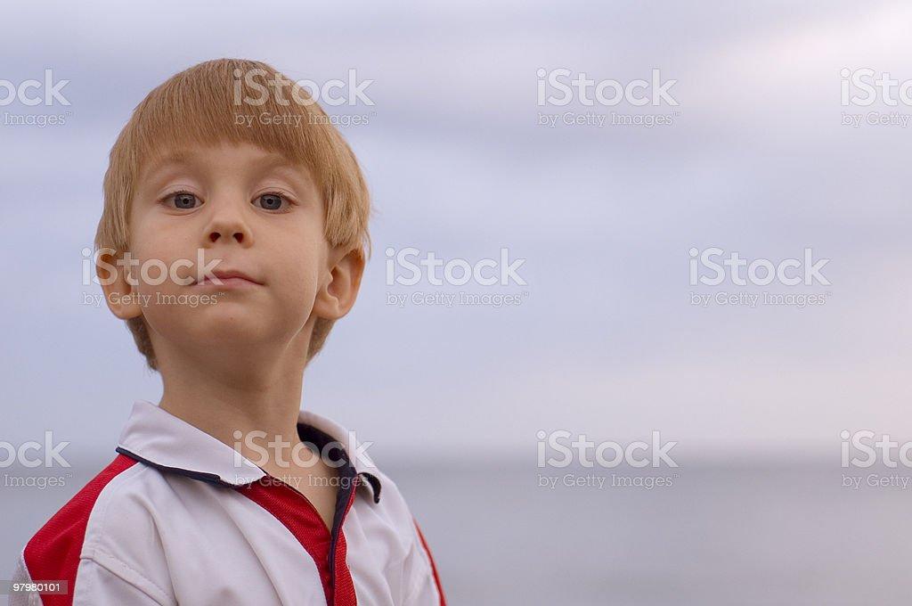 adorable young boy looking at camera royalty-free stock photo
