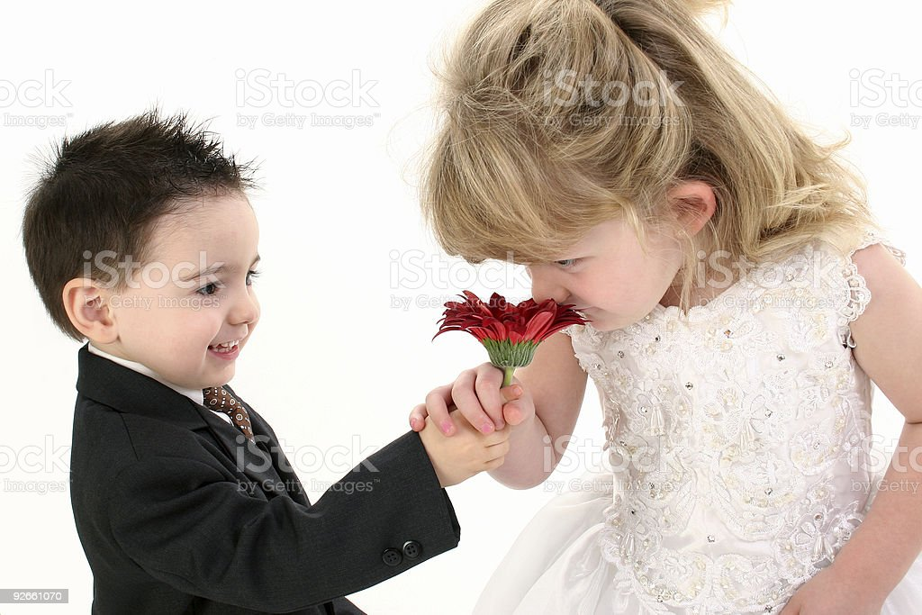 Adorable Young Children Smelling Daisy Together royalty-free stock photo