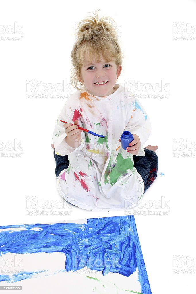 Adorable Young Girl Painting Poster Board on Floor royalty-free stock photo