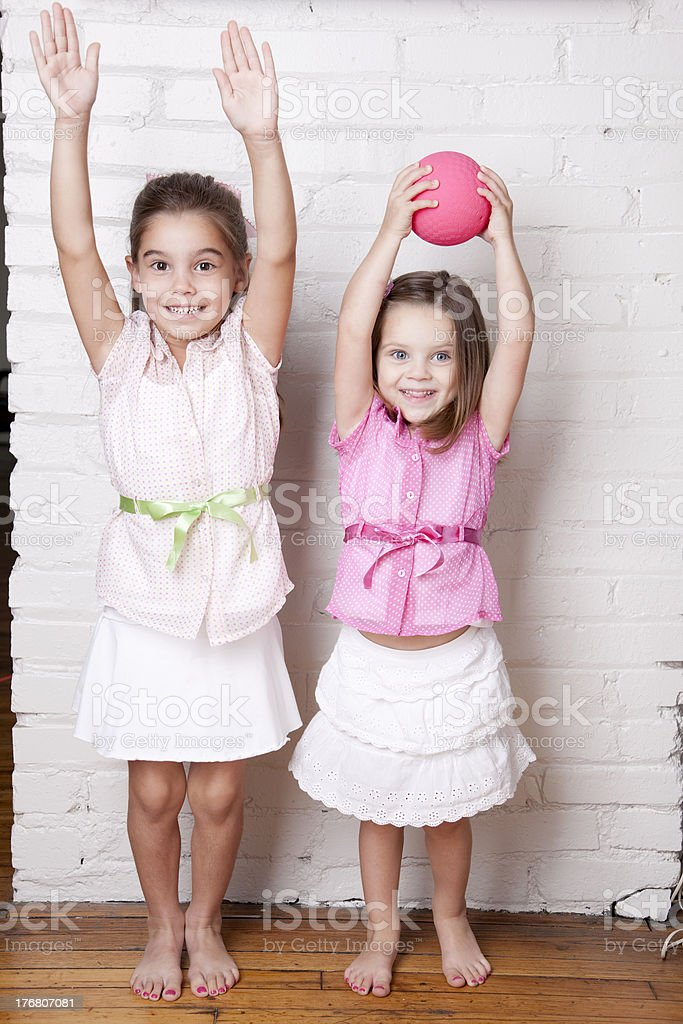 Adorable Young Sisters Play Together royalty-free stock photo
