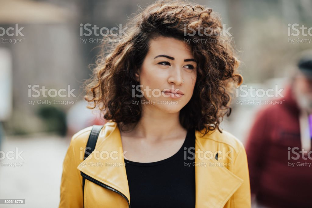 Adorable young woman with beautiful curly hair stock photo