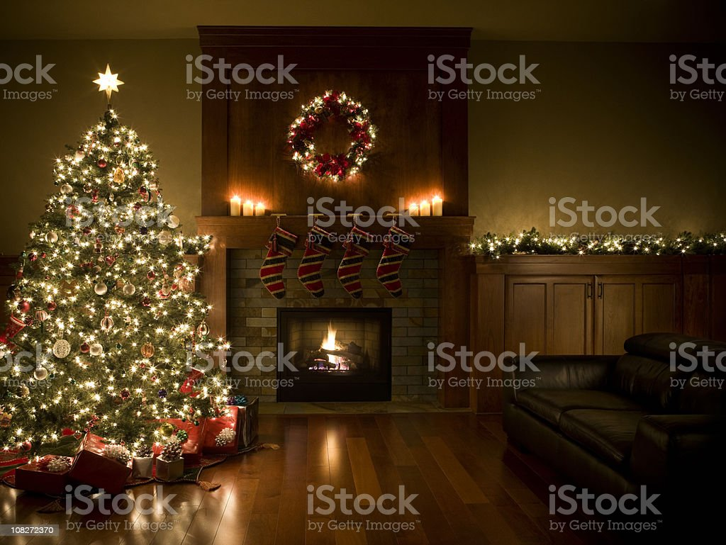 Adorned Christmas Tree, Wreath, and Garland Inside Living Room, Copyspace stock photo