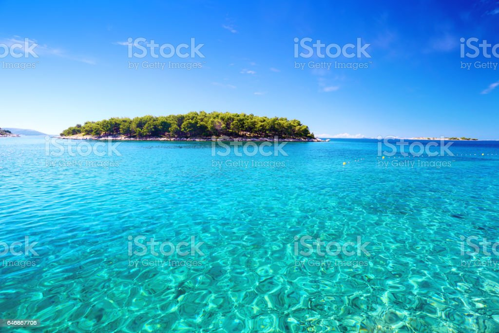 Adriatic sea clear water with island stock photo