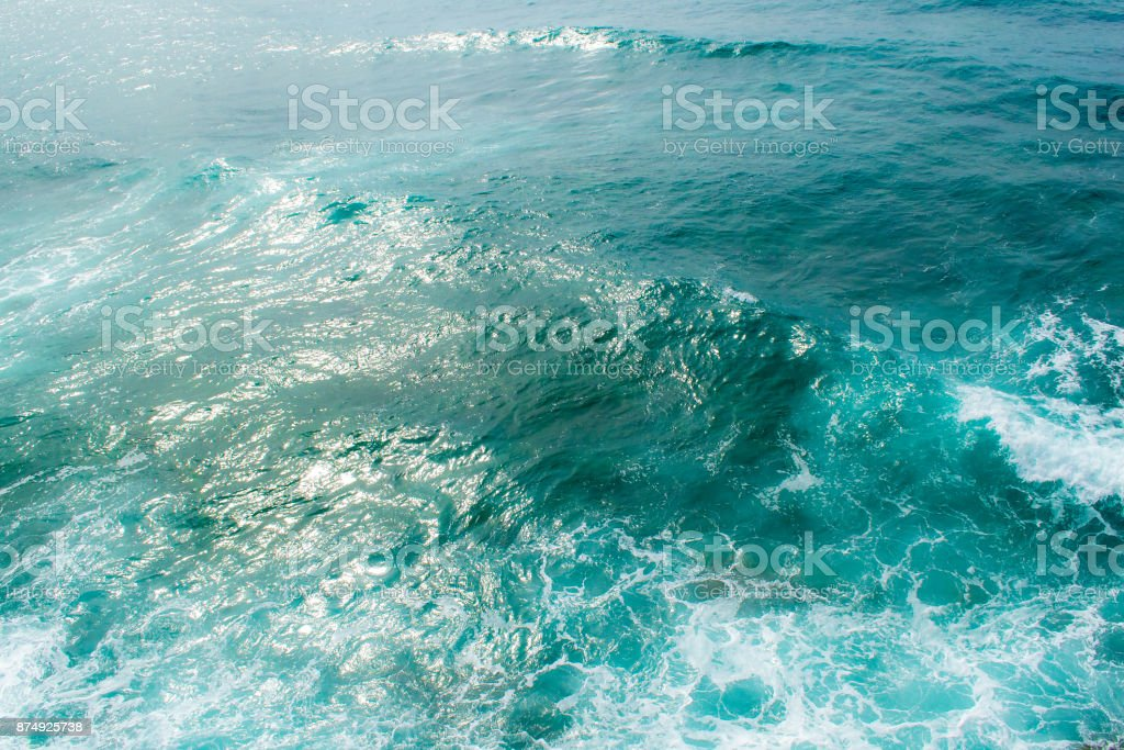 Adriatic Sea in windy weather. Waves and foam, sun glare on the water. View from above. stock photo