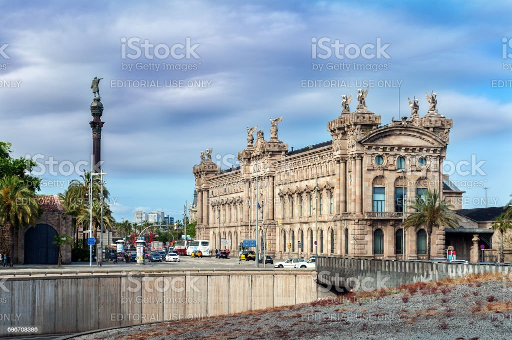 Aduana de Barcelona, old customs building (designed by Sagnier i Villavecchia) built in neoclassical style and sculpture of Cristopher Colambus near it. stock photo