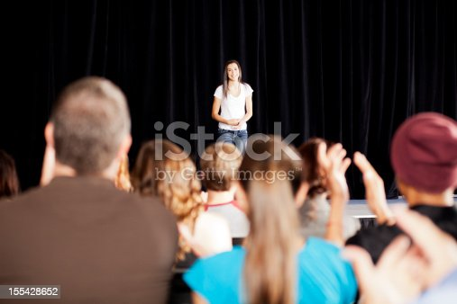 istock Adudience clapping for a teenage girl on stage 155428652