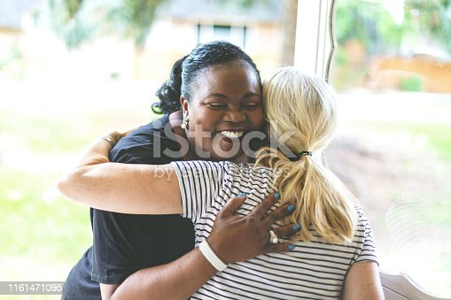 Adult African American Female and caucasian Female at front door of residence welcoming a visit in Western Colorado  (Shot with Canon 5DS 50.6mp photos professionally retouched - Lightroom / Photoshop - original size 5792 x 8688)