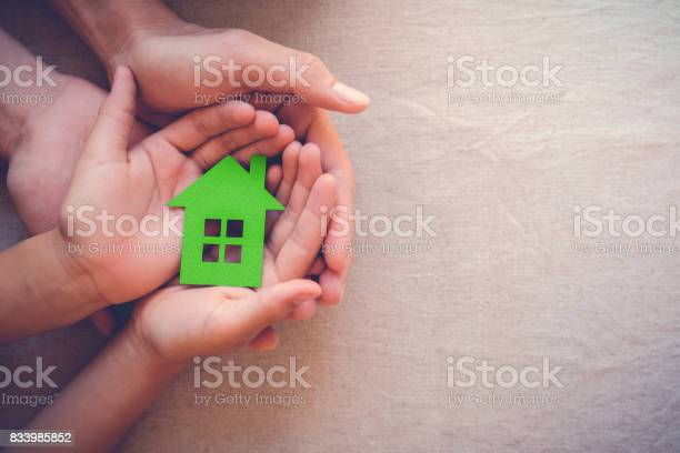 Adult and child hands holding green paper house eco house concept picture id833985852?b=1&k=6&m=833985852&s=612x612&h=bbkm9k57cdzubbuyefivc6pwlbyjqjhtccpwwlkj6r4=