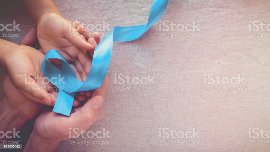 Adult and child hands holding Light blue, sky blue ribbons, toning background, Prostate Cancer Awareness and Adrenocortical carcinoma awareness
