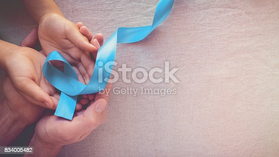 istock Adult and child hands holding Light blue, sky blue ribbons, toning background, Prostate Cancer Awareness and Adrenocortical carcinoma awareness 834005482