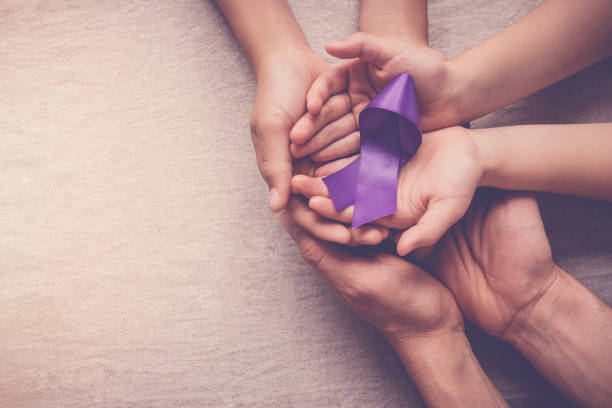 Adult and child hands holding purple ribbon, Alzheimer's disease, Pancreatic cancer, Epilepsy awareness, world cancer day Adult and child hands holding purple ribbon, Alzheimer's disease, Pancreatic cancer, Epilepsy awareness, world cancer day dime stock pictures, royalty-free photos & images