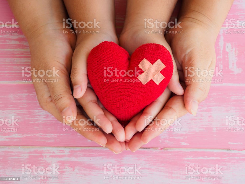 Adult And Child Hands Holding Red Heart Stock Photo Download Image Now Istock