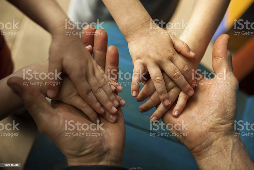 Adult and children hands stock photo