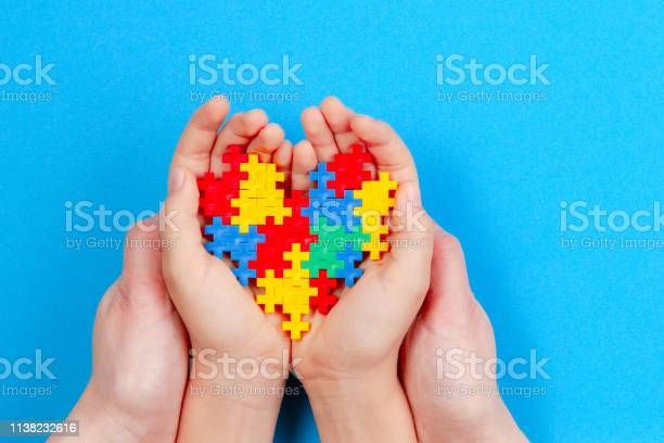Adult and kid hands holding colorful heart on blue background world picture id1138232616?b=1&k=6&m=1138232616&s=612x612&h= fzateogwlkpdbrhfton2fnlemjc1yliabck7m1x bc=