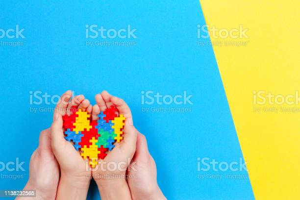Adult and kid hands holding colorful heart on yellow and blue world picture id1138232565?b=1&k=6&m=1138232565&s=612x612&h=m mvgxwvulvapr1fu5husqpmpu63onuvbsb1go3ssos=