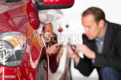 An insurance expert examining case of damage at car. Car Insurance, appraiser. Horizontal indoors picture