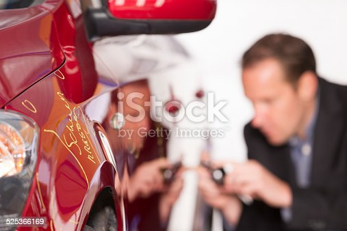 istock Adult appraiser looking at car, estimate for fix 525366169
