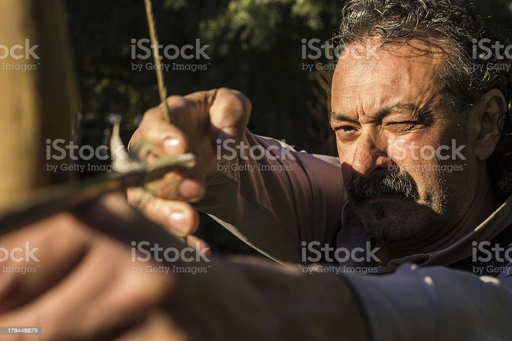 Adult archer is about to shoot Arrow royalty-free stock photo