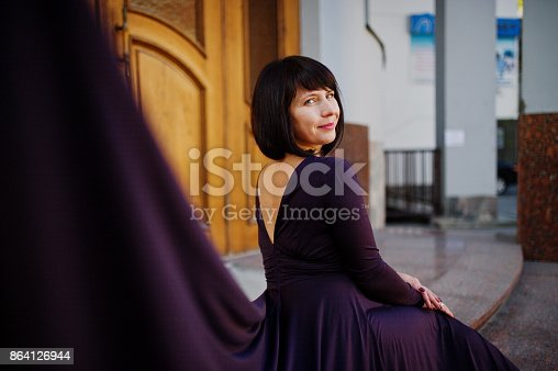 Adult Brunette Woman At Violet Gown Stock Photo & More Pictures of Adult