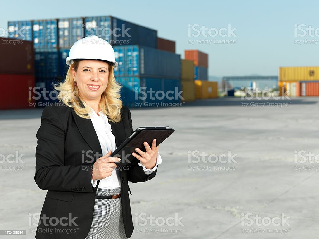 Adult Businesswoman in Container Warehouse royalty-free stock photo