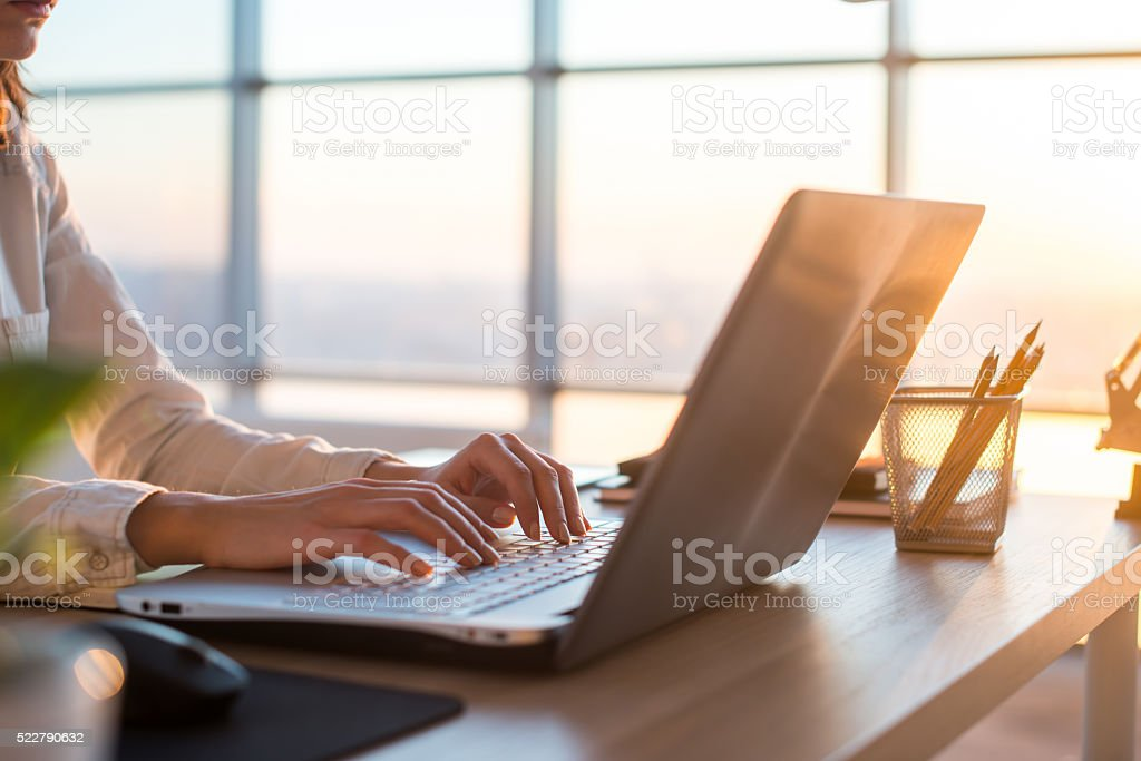 Adult businesswoman working at home using computer, studying business ideas bildbanksfoto