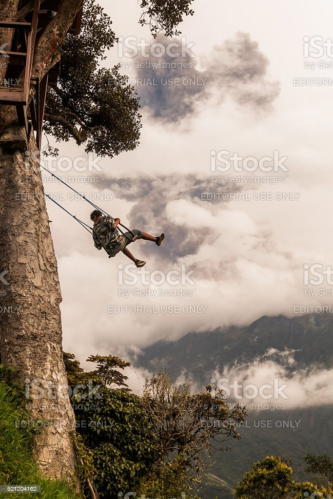 Adult Caucasian Man Swinging On A Swing In Banos stock photo