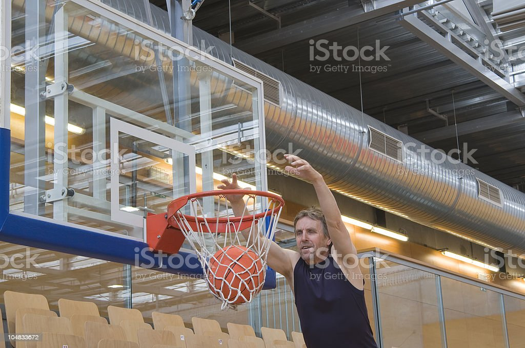 Adult Caucasian Throwing Ball into Hoop royalty-free stock photo