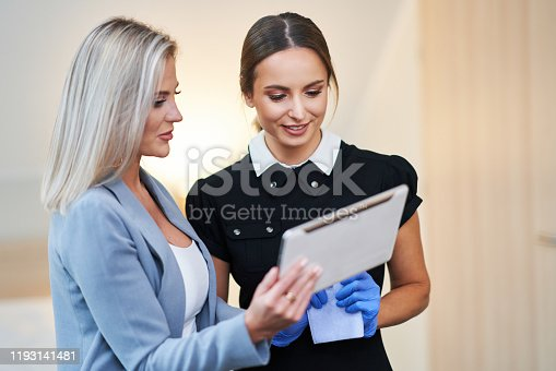 istock Adult chambermaid and hotel manager cleaning the room 1193141481