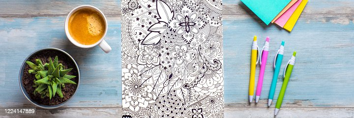 istock Adult coloring book, stress relieving trend. Art therapy, mental health, creativity and mindfulness concept. Flat lay web banner, panoramic close up shot. 1224147889