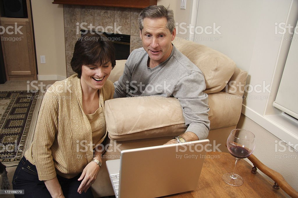 adult couple browsing the net: excited royalty-free stock photo