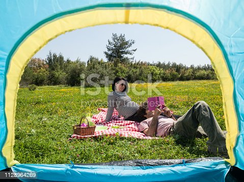 930810564 istock photo Adult Couple Camping In Nature During Springtime 1128964269