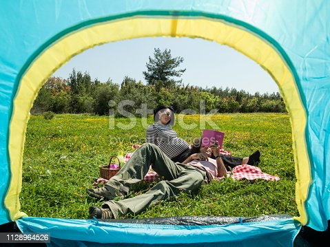 930810564 istock photo Adult Couple Camping In Nature During Springtime 1128964526