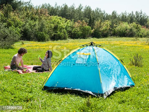 istock Adult Couple Camping In Nature During Springtime 1128965723