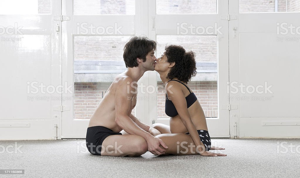 adult couple kissing in yoga studio royalty-free stock photo