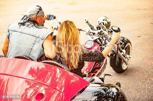 Adult Couple on Trike enjoying a ride. Custom homemdade trike. Property released.