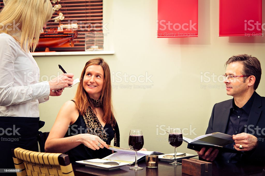 adult couple ordering food royalty-free stock photo