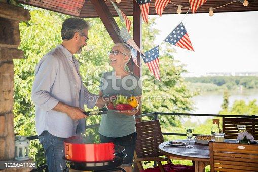 Adult couple decorating house for celebrating