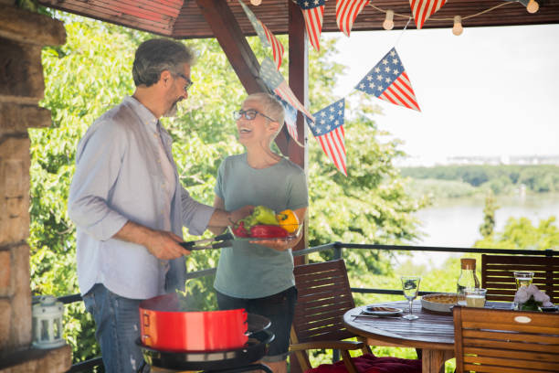Adult couple Adult couple decorating house for celebrating family 4th of july stock pictures, royalty-free photos & images