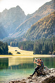 Adult Couple Relaxing By a Kettle Lake in Julian Alps in Italy.