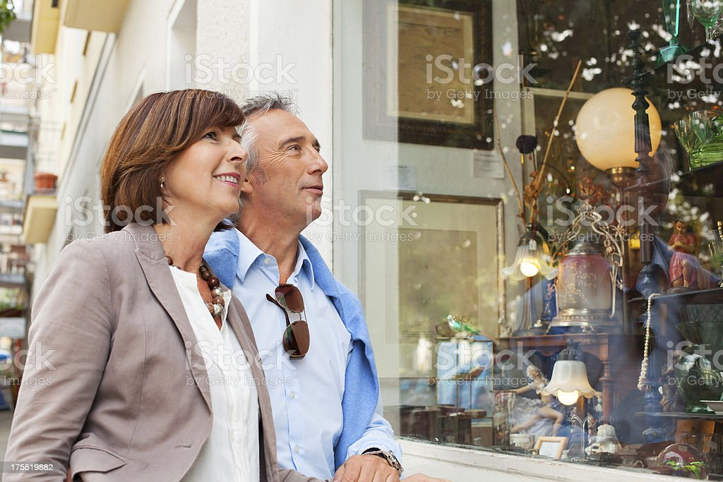 Adult couple shopping in an antique shop stock photo