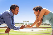 istock Adult couple toasting and smiling with champagne. 475077836