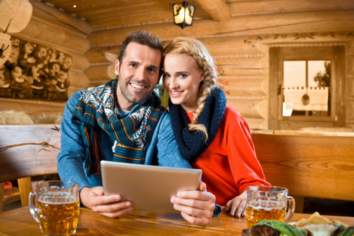 Adult Couple Using Digital Tablet Stock Photo - Download Image Now
