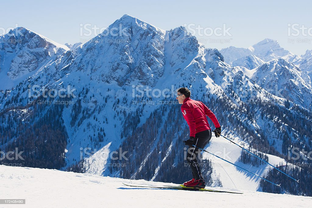Adult cross country skier in the mountains royalty-free stock photo