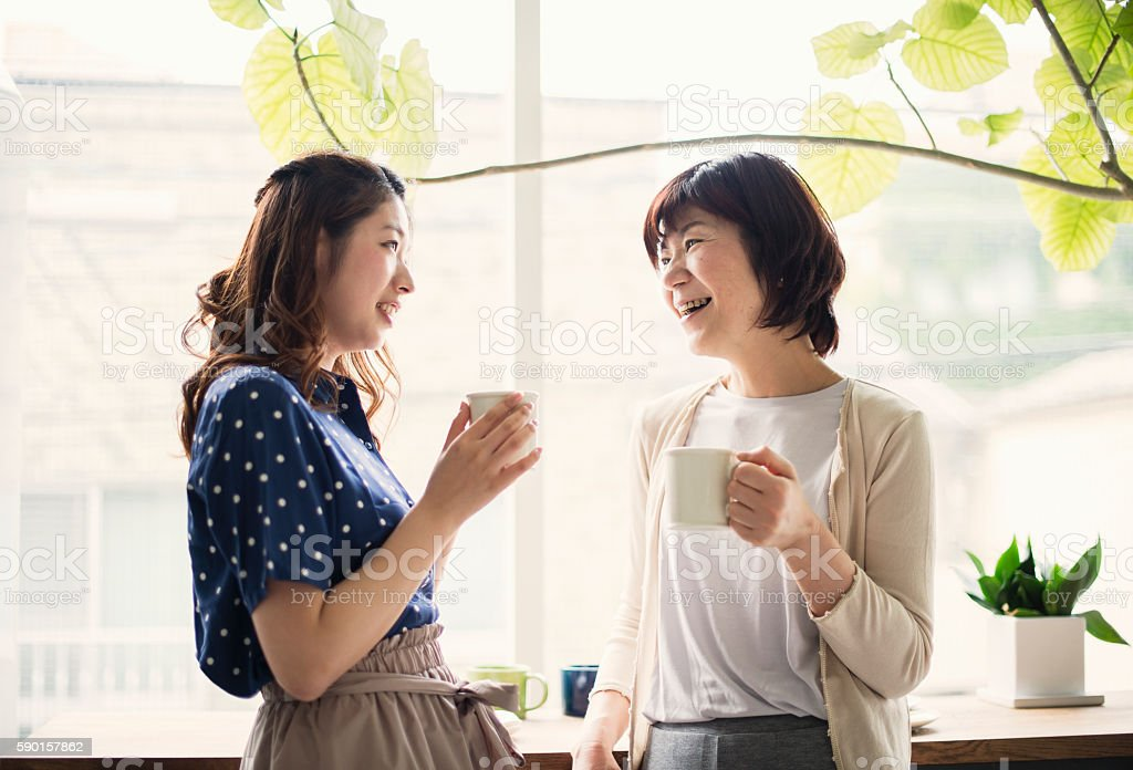 Adult daughter and mother having a good time stock photo