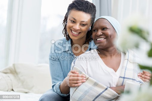 932074776 istock photo Adult daughter cares for aging mother 936497078