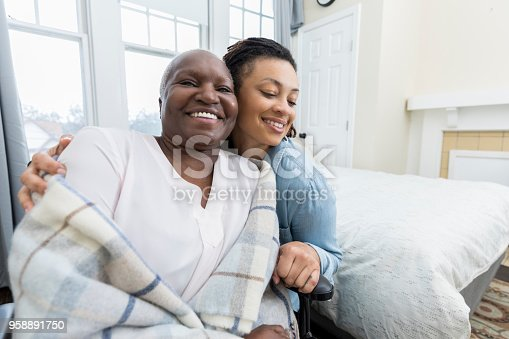 932074776 istock photo Adult daughter cares for senior mother 958891750