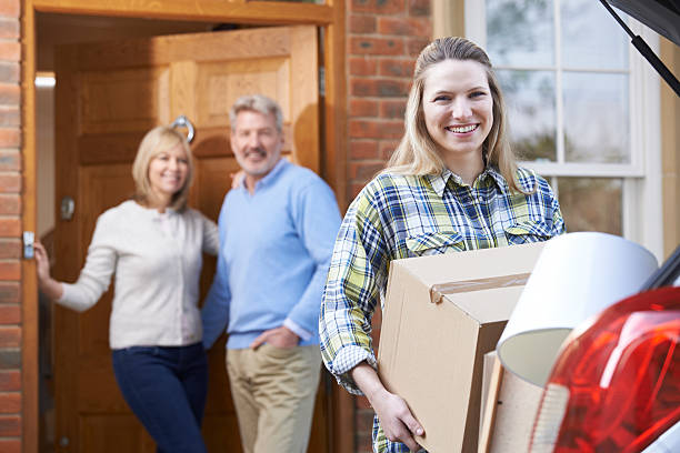 adult daughter moving out of parent's home - leaving stock photos and pictures