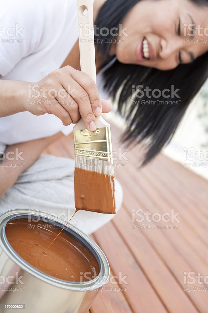 Adult dipping paint brush stock photo